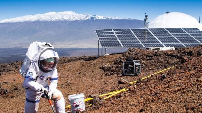 A scientist steps outside of the dome set up on the bleak slopes of dormant volcano Mauna Loa in Hawaii. Picture: AP/University of Hawaii