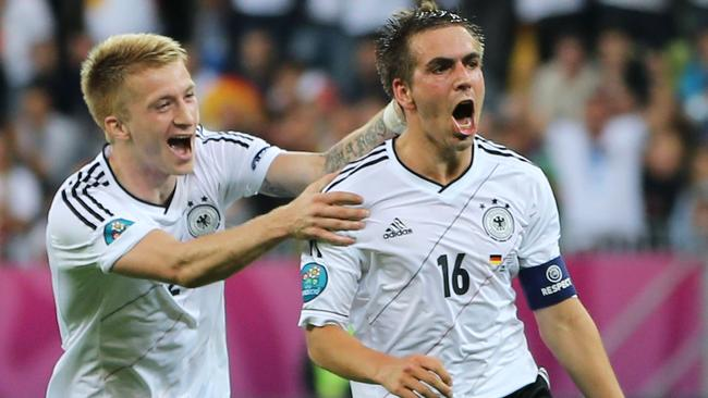 Dortmund ace Marco Reus (L) could join country captain Phillip Lahm in Munich.