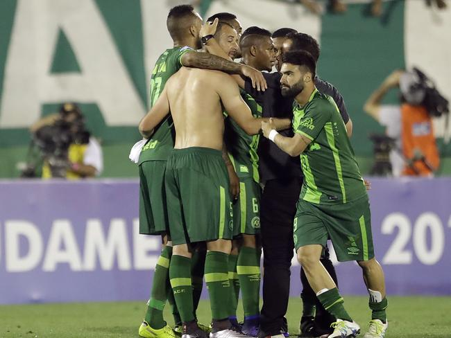 Players of Brazil's Chapecoense celebrate at the end of the Copa Sudamericana semi-final football match against Argentina's San Lorenzo in Chapeco, Brazil, on November 23. Picture: Andre Penner.