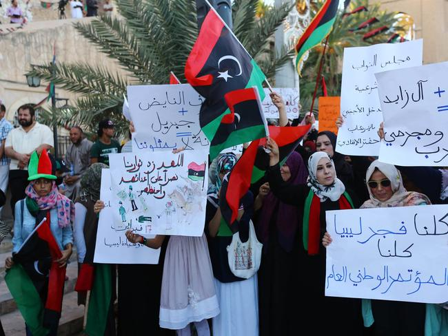 Sliding into chaos ... demonstrators rally in support of Fajr Libya (Libya Dawn) in Martyrs' Square in the Libyan capital Tripoli. Picture: Mahmud Turkia