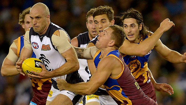 NAB Cup,Grand Final,Carlton v Brisbane,Chris Judd tackled by Brent Moloney, Picture: Ludbey Wayne