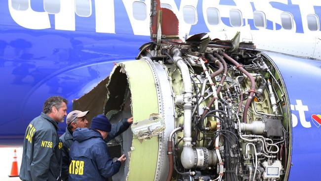 National Transportation Safety Board investigators have examined damage to the engine of the Southwest Airlines.