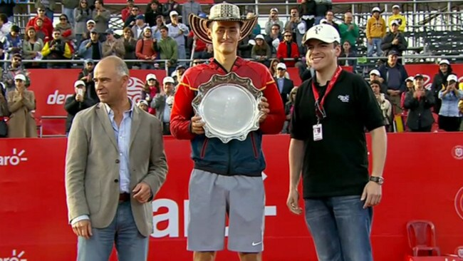 Bogota champion Bernard Tomic...and his new hat.