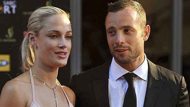Before the tragedy: Pistorius with girlfriend Reeva Steenkamp. Picture: AP