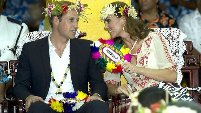 Prince William, Duke of Cambridge and Catherine, Duchess of Cambridge watch the dancing ladies at the Vaiku Falekaupule in Tuvalu. Picture: Arthur Edwards