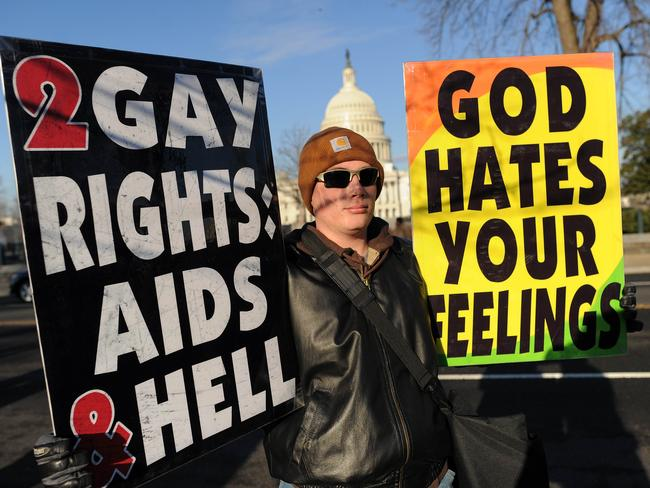 Anti-gay messages, like these held by a protester in front of the US Supreme Court, will be allowed to be broadcast without being bound by regular advertising laws. Picture: Jewel Samad/AFP