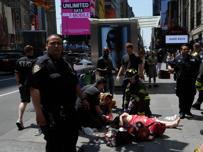 First responders attend to an injured woman after a car plunged into pedestrians in Times Square in New York. Picture: AFP/Jewel Samad