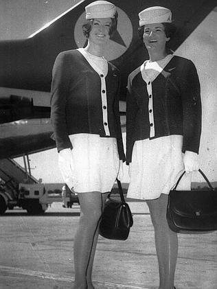 Flight attendant uniforms circa 1972 — with handbags.