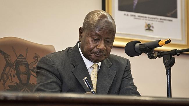 Gay rights...Uganda's President Yoweri Museveni signs a new anti-gay bill that sets some of the world's harsh penalties for homosexual sex, including life in prison. Picture: AP