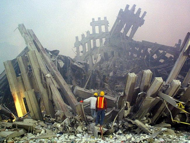 Aftermath ... Rescue workers survey damage to the World Trade Center after September 11, 2001. AFP/Doug Kanta