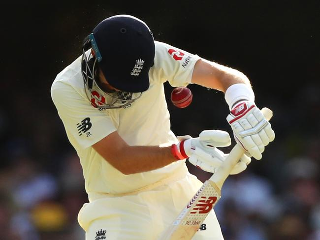 Joe Root takes his eyes off the ball - and it crashes into his helmet. (Photo by Cameron Spencer/Getty Images)