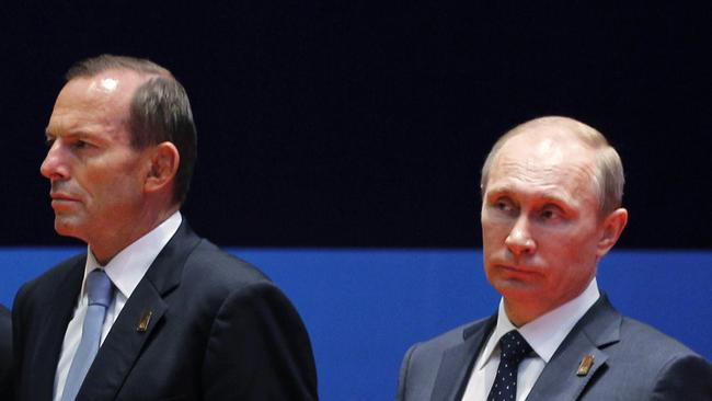Cold shoulder: Australian Prime Minister Tony Abbott and Russian President Vladimir Putin's relationship just got a little icier. Picture: AP