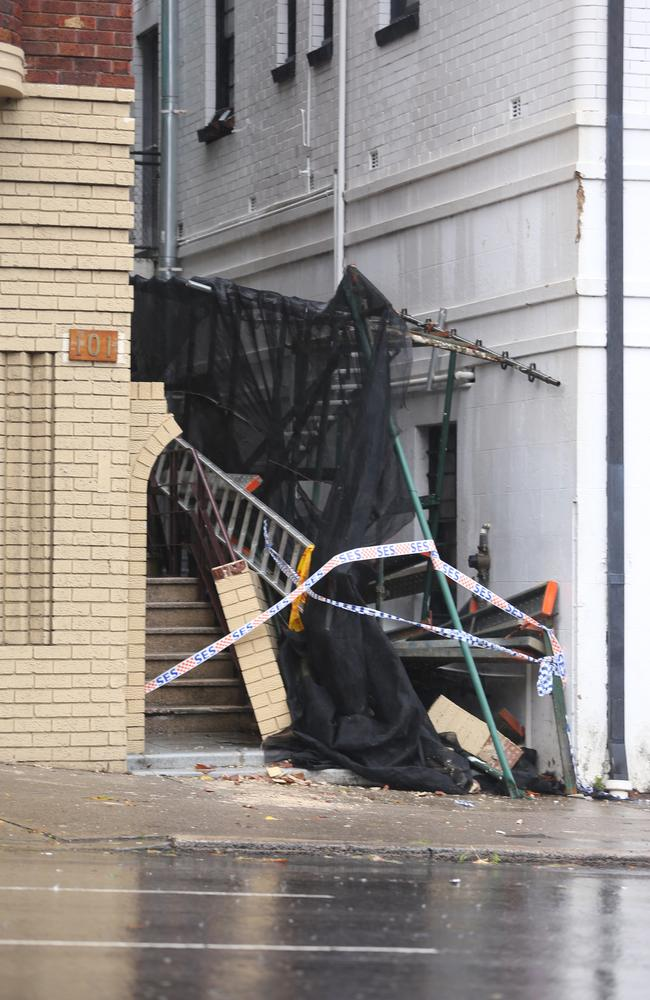 A severe storm still lashing Sydney has caused major damage. Collapsed scaffolding is seen here at Edgecliff, Sydney.
