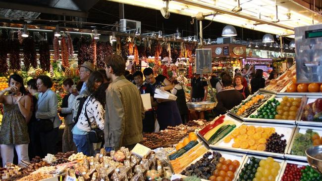City officials in Barcelona have sought to control tourists at La Boqueria markets, one of the city's biggest tourist attractions. Picture: Ulf Liljankoski
