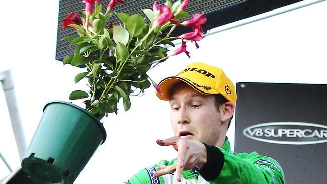 David Reynolds throws a flower pot after his first win.