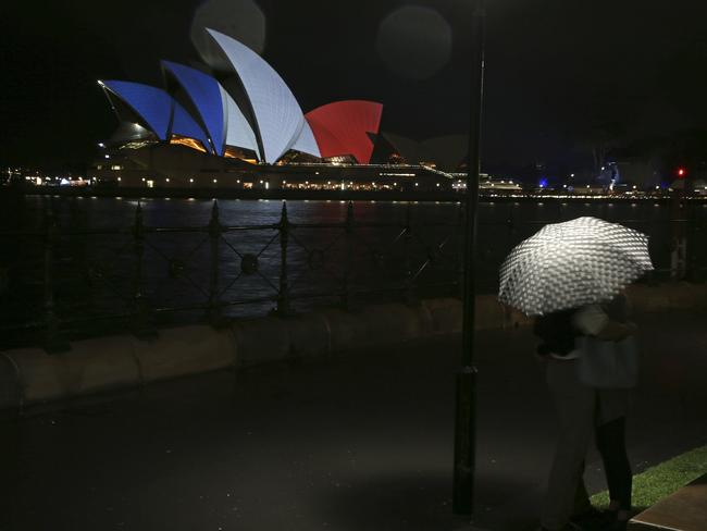 Solidarity ... Sydney's Opera House was adorned with the red, white and blue of France's flag.