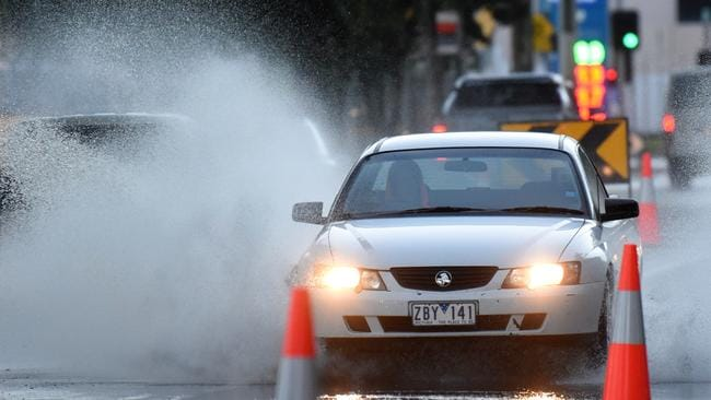 Water lays on Dynon road West Melbourne after heavy rain overnight. Picture: Nicole Garmston