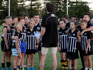 Junior footy huddle