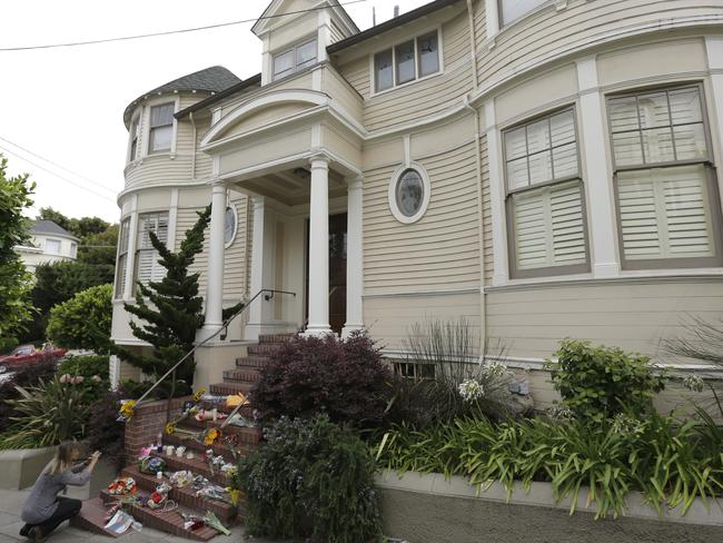 A woman photographs mementos left on the steps of a residence in San Francisco featured in  <i>Mrs Doubtfire</i>. Picture: AP Photo/Ben Margot