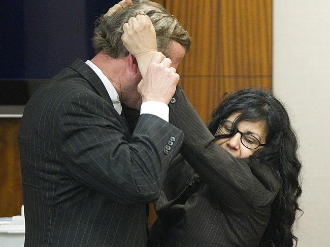 'Pure self defence' ... lawyer Jack Carroll, left, and Ana Trujillo demonstrate the fight that led to a fatal stabbing. Picture: Brett Coomer