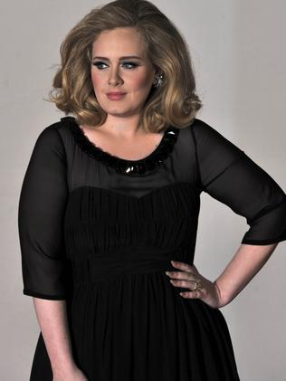British singer-songwriter Adele poses on the red carpet at the Brit Awards in 2012. Picture: AFP/Ben Stansall