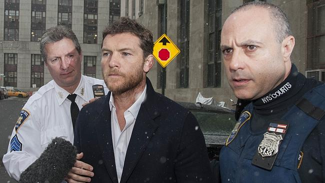 Court appearance ... Avatar star Sam Worthington arrives at court accused of assaulting paparazzo Sheng Li in Greenwich Village. Picture: Steven Hirsch / Splash News