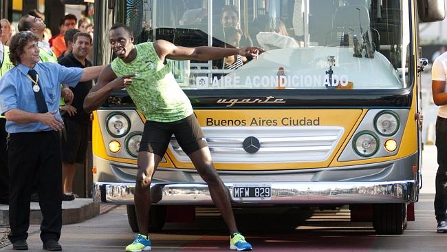 Jamaican sprinter Usain Bolt celebrates next to the driver of the Metrobus after winning a 100-meter race against the bus in Buenos Aires.
