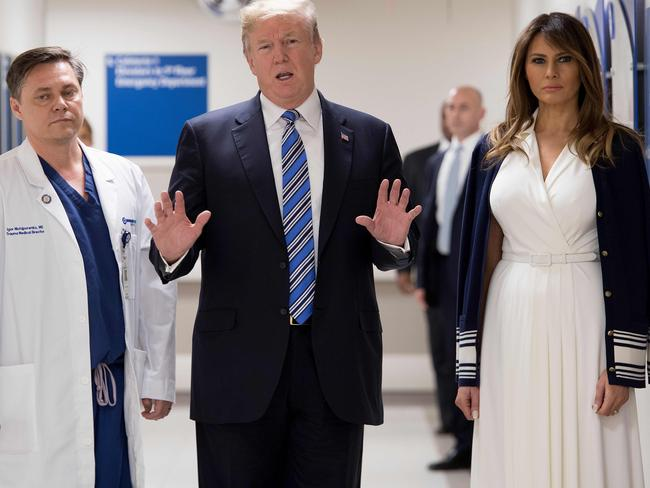Broward Health North hospital's Dr Igor Nichiporenko with US President Donald Trump and First Lady Melania Trump as they visit first responders and victims from last week's shooting. Picture: Jim Watson/AFP