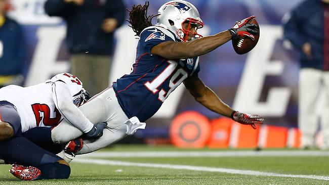 Donte' Stallworth #19 of the New England Patriots dives across the goal line to score a touchdown in the third quarter against the Houston Texans during the game at Gillette Stadium on December 10, 2012 in Foxboro, Massachusetts. Jared Wickerham/Getty Images/AFP