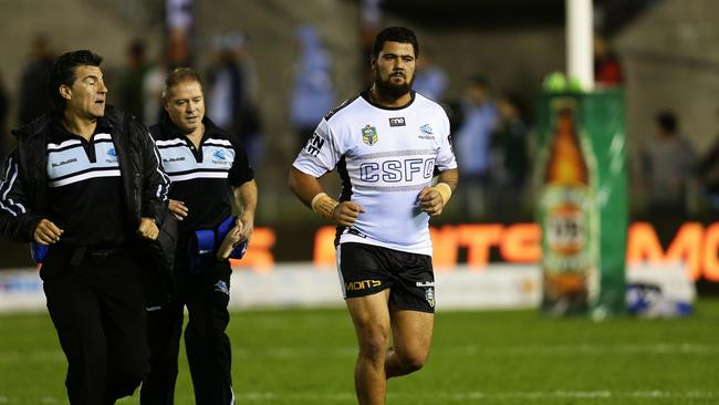 Cronulla's David Fifita leaves the field with an injury during warm up.