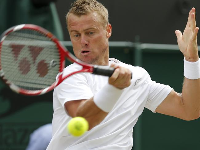 Lleyton Hewitt plays a return to Jerzy Janowicz during their men's singles match. Picture: Ben Curtis
