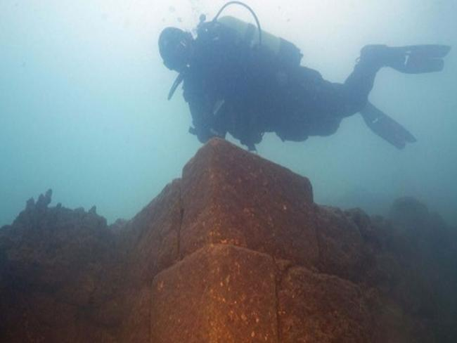 A diver is pictured over a corner of the ancient walls of a submerged fortress, found under Lake Van near Turkey's border with Iran. Picture: IHA