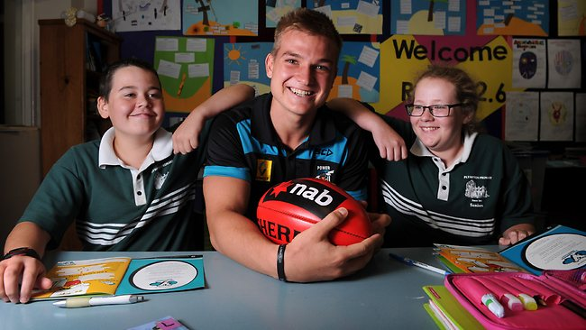 Rising Star Award nominee Oliver Wines with Plympton Primary School Year 7 students James and Victoria. Picture: Tricia Watkinson.