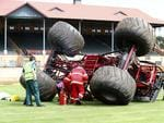 Motorsport fire and rescue crew rush in to check on Mr Christensen. Picture: Sarah Reed