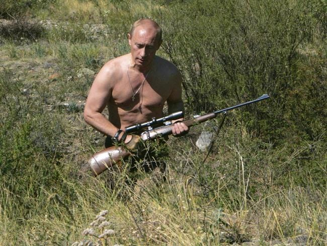Commando ... Russian President Vladimir Putin walks holding a rifle in the Tuva region of Siberia.