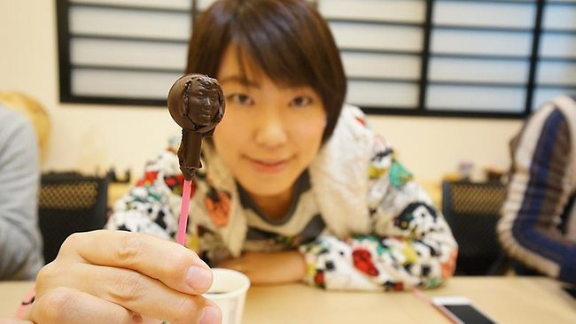 Customers can make chocolates using 3D-printed molds of their own faces. Picture: Fab Cafe