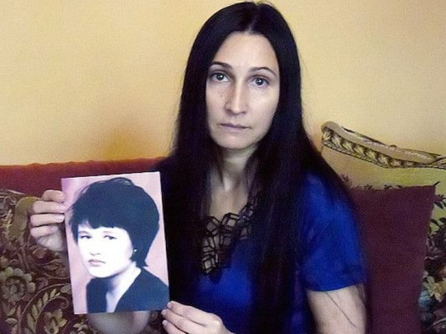 Viktoria Martynova holds a picture of her sister Tanya, who Popkov murdered when she was 20 years old in 1998. Picture: Siberian Times.