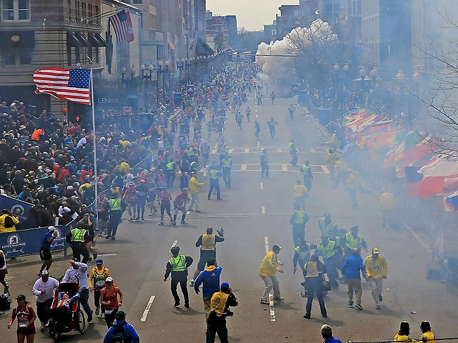People react as an explosion goes off near the finish line. Two explosions went off at the Boston Marathon finish line on Monday, sending authorities out on the course to carry off the injured while the stragglers were rerouted away from the smoking site of the blasts. Picture: AP