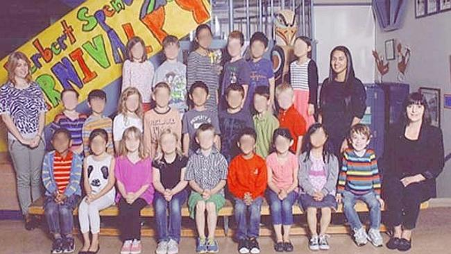 The reshoot: Miles, second from left in the front row, gets to sit with his classmates. Picture: Supplied