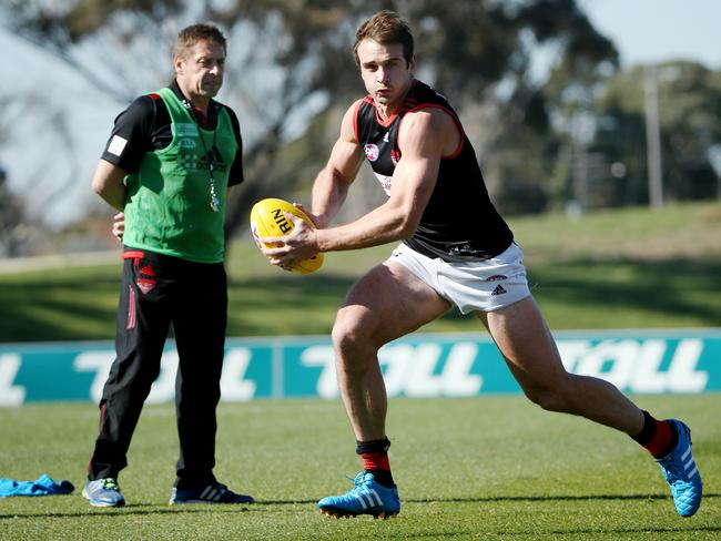 Mark Thompson keeps an eye on Jobe Watson at Tullamarine. Picture: Colleen Petch.