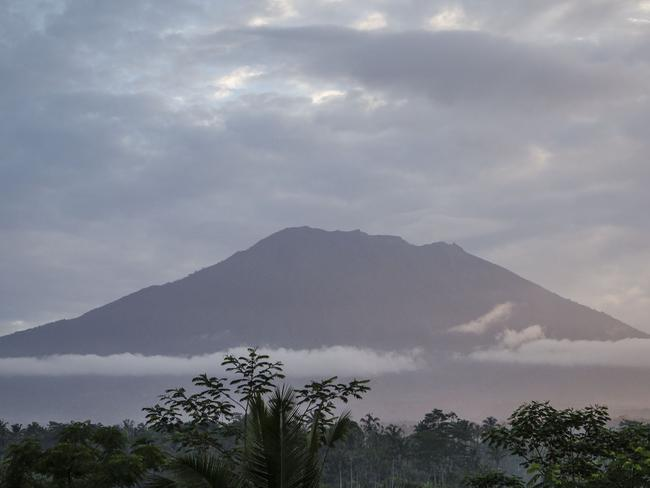 KARANGASEM, BALI, INDONESIA - SEPTEMBER 24: A view of mount Agung  on September 24, 2017 in Karangasem regency, Island of Bali, Indonesia. Indonesian authorities raised the alert level for the Mount Agung volcano to the highest level as up to 30,000 villagers around the mountain evacuated their homes and travel warnings have been issued for the popular tourist destination. (Photo by Ulet Ifansasti/Getty Images)