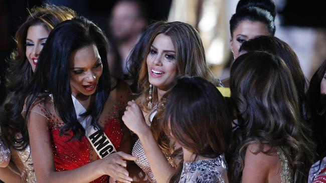Hard to take ... Contestants comfort Miss Colombia Ariadna Gutierrez after she was incorrectly crowned Miss Universe.