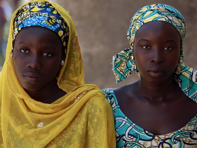 Lucky escape ... Joy Bishara, left, and Hadiza Fali, two of the girls that escaped being kidnapped by Islamist extremists by jumping off a truck.