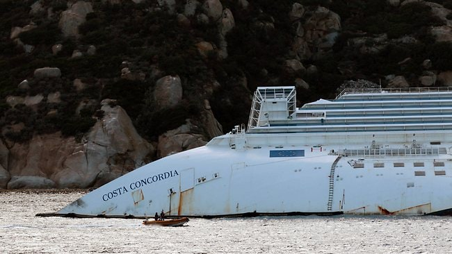 A view of the partially sunk Costa Concordia wreckage next to the Giglio Island, Italy. Picture: AP