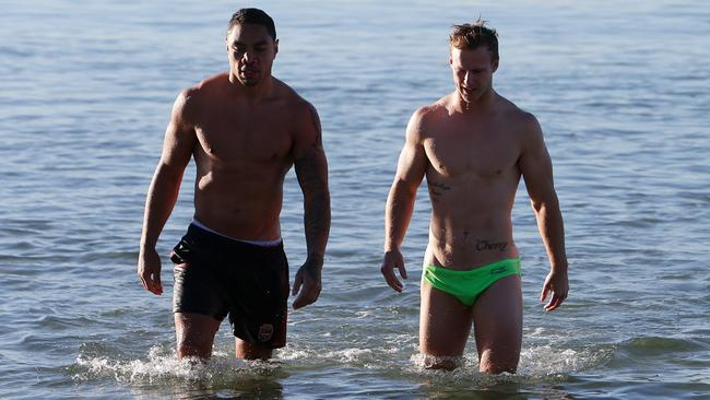 Maroons Willie Tonga and Daly Cherry-Evans go for a swim at the beach. Picture: Peter Wallis