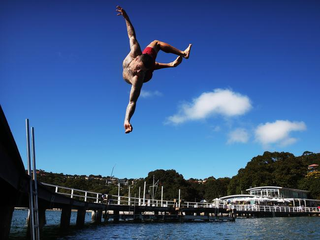Dom Reardon makes a big leap into the water at Balmoral to cool off today. Picture: Phil Hillyard