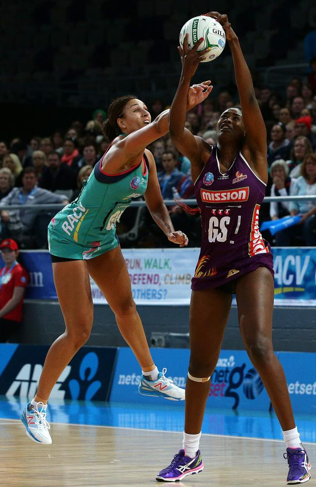 Firebirds' GS Romeld Aiken (R) in a contest for possession with Vixens' GK Geva Mentor