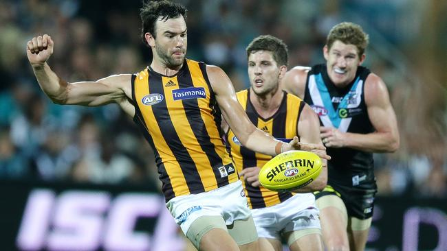 Hawk Jordan Lewis is equally as damaging with ball in hand as he is jumping third-man up in the ruck contest. Picture: Sarah Reed