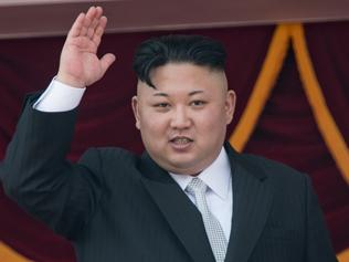 "(FILES) This file photo taken on April 15, 2017 shows North Korean leader Kim Jong-Un waving from a balcony of the Grand People's Study house following a military parade marking the 105th anniversary of the birth of late North Korean leader Kim Il-Sung, in Pyongyang. US President Donald Trump on May 1, 2017 said he would not rule out meeting North Korean leader Kim Jong-Un, saying he would be ""honored to do it,"" despite weeks of tough talk against the regime.""If it would be appropriate for me to meet with him I would absolutely. I would be honored to do it,"" Trump said in an interview with Bloomberg. / AFP PHOTO / ED JONES"
