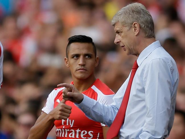 Arsene Wenger gets his point across to new signing Alexis Sanchez.